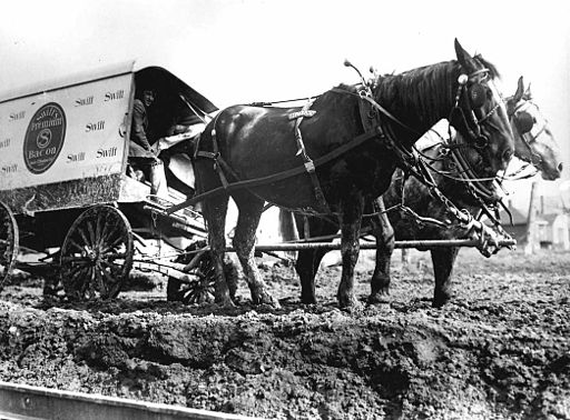 512px-Horses_and_delivery_wagon_stuck_in_the_mud